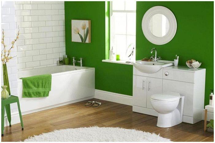 Łazienka utrzymana jest w jasnej zieleni.