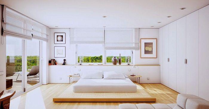 Интересный интерьер спальной, которая оформлена в светлых тонах, что создает дополнительную легкость в интерьере.