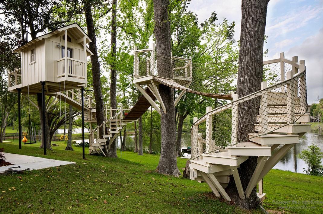 Оригинальная установка детских конструкций вокруг деревьев