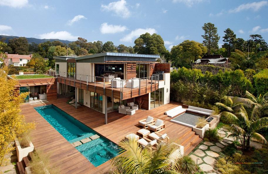 Необычный дизайн дома с красивым местом расположения и площадкой